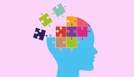Profilo di un cranio costruito da pezzi di puzzle, alcuni mancanti