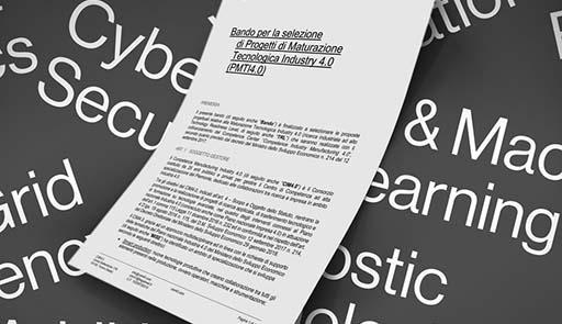 """Foglio di carta con titolo del bando """"Progetti di Maturazione Tecnologica – Industria 4.0"""""""