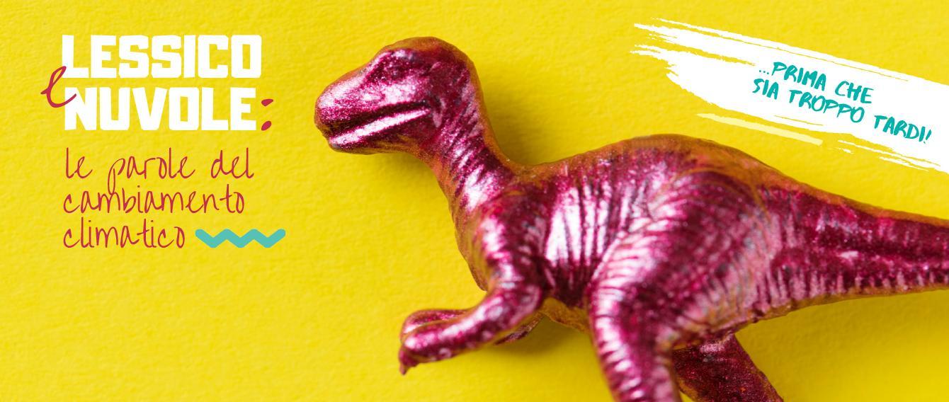 Dinosauro plastificato su sfondo colorato