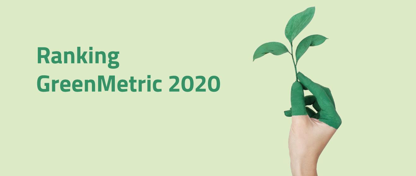 mano tinta di verde sostiene un rametto di foglioline verdi